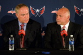 General Manager Brian MacLellan answers questions as coach Barry Trotz both of the Washington Capitals looks on during their introductory press...