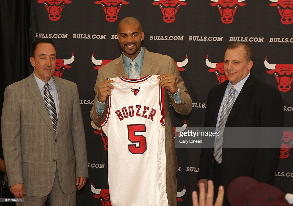 General Manager Gar Forman, <a gi-track='captionPersonalityLinkClicked' href=/galleries/search?phrase=Carlos+Boozer&family=editorial&specificpeople=201638 ng-click='$event.stopPropagation()'>Carlos Boozer</a> #5, and Head Coach <a gi-track='captionPersonalityLinkClicked' href=/galleries/search?phrase=Tom+Thibodeau&family=editorial&specificpeople=2162261 ng-click='$event.stopPropagation()'>Tom Thibodeau</a> of the Chicago Bulls pose for a photograph following Boozer's signing as a free agent on July 9, 2010 at the Berto Center in Deerfield, Illinois.