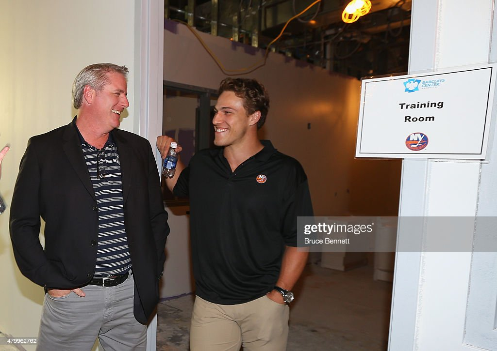 General Manager Garth Snow and players Anders Lee of the New York islanders tour the new facilities prior to the 2015 New York Islanders Blue & White Rookie Scrimmage & Skills Competition at the Barclays Center on July 8, 2015 in Brooklyn borough of New York City.