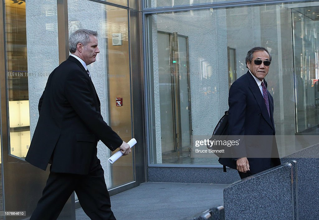 General Manager Garth Snow and team owner Charles Wang of the New York Islanders leave the leagues legal offices following the National Hockey League Board of Governors meeting on December 5, 2012 in New York City.