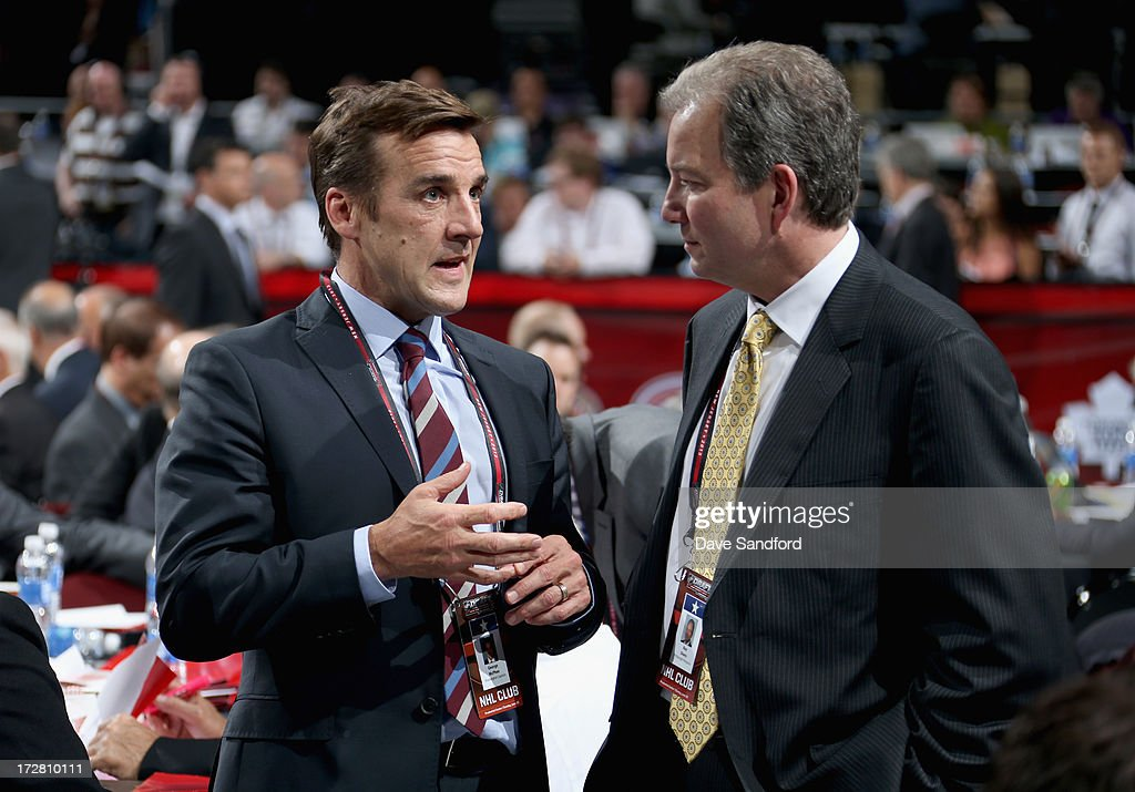 General Manager George McPhee of the Washington Capitals chats with general manager Ray Shero of the Pittsburgh Penguins during the 2013 NHL Draft at Prudential Center on June 30, 2013 in Newark, New Jersey.