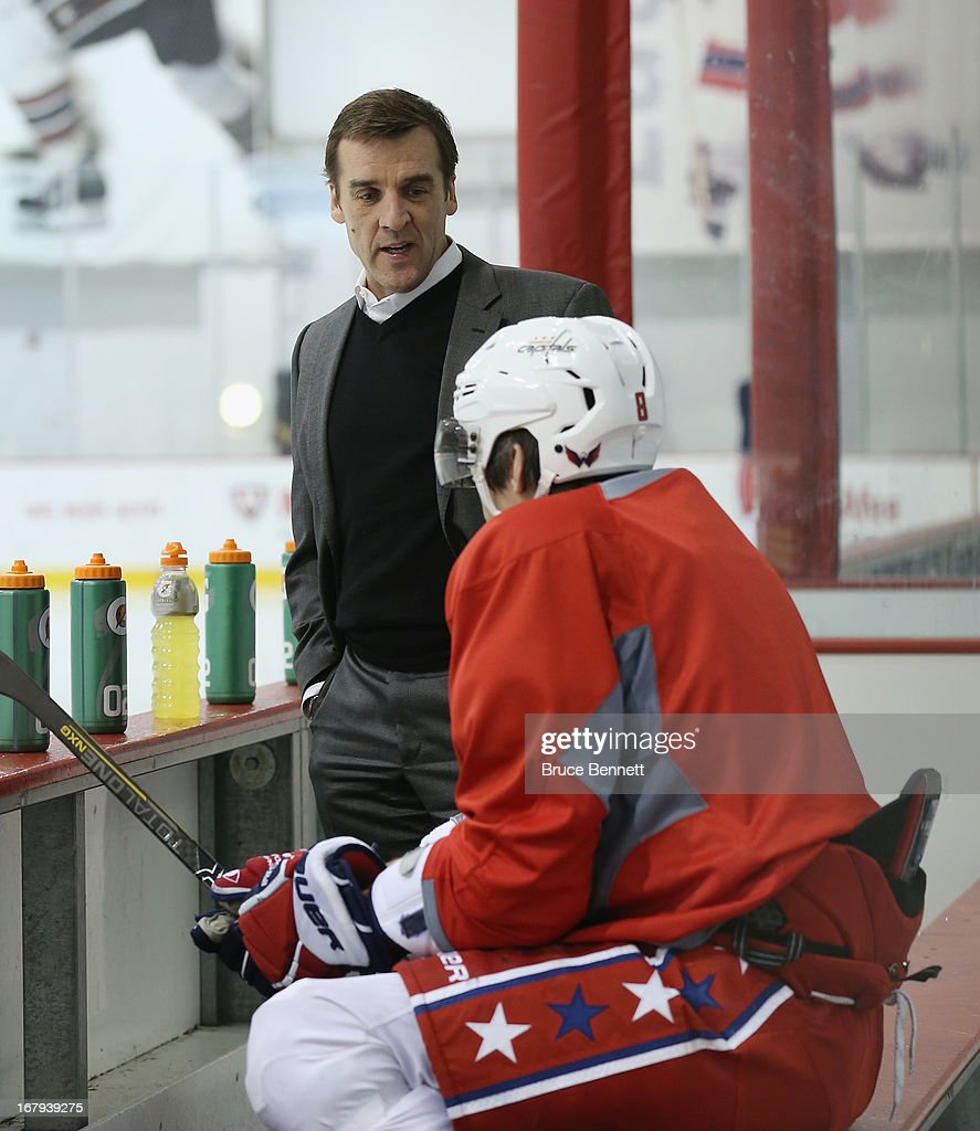 General Manager George McPhee speaks with Alex Ovechkin #8 of the Washington Capitals at the Kettler Capitals Iceplex on February 23, 2013 in Arlington, Virginia.