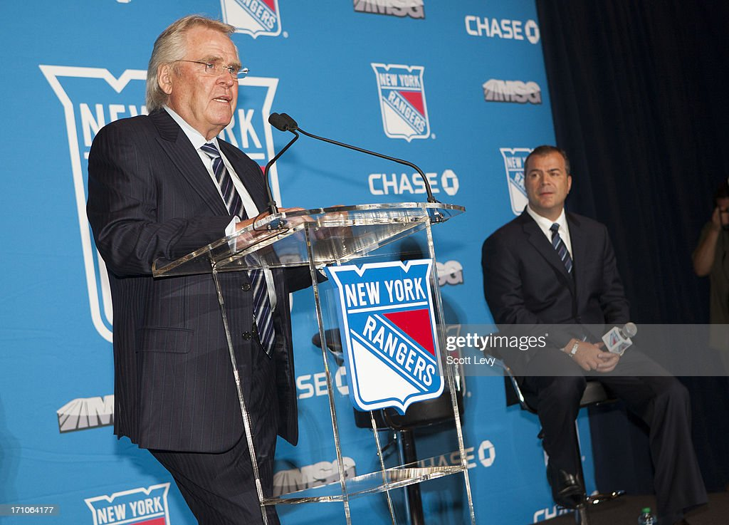 General Manager <a gi-track='captionPersonalityLinkClicked' href=/galleries/search?phrase=Glen+Sather&family=editorial&specificpeople=207190 ng-click='$event.stopPropagation()'>Glen Sather</a> of the New York Rangers (L) introduces <a gi-track='captionPersonalityLinkClicked' href=/galleries/search?phrase=Alain+Vigneault&family=editorial&specificpeople=4146583 ng-click='$event.stopPropagation()'>Alain Vigneault</a> as the new Rangers coach at Radio City Music Hall on June 21, 2013 in New York City.