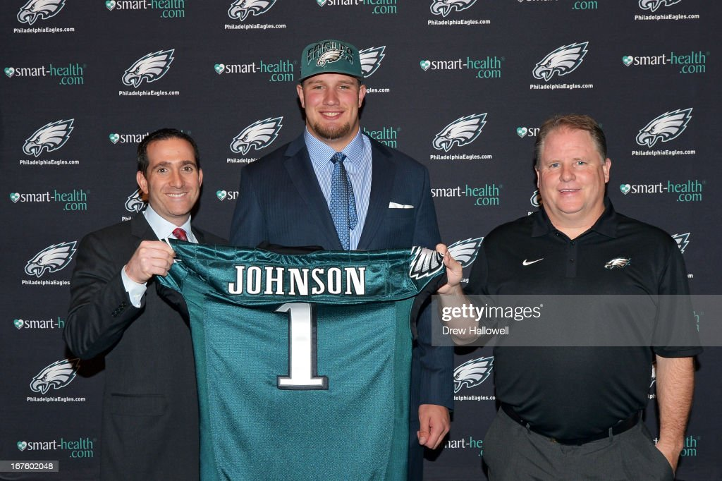 General Manager Howie Roseman, first round draft pick Lane Johnson and head coach Chip Kelly of the Philadelphia Eagles pose for a photograph at the NovaCare Complex on April 26, 2013 in Philadelphia, Pennsylvania.