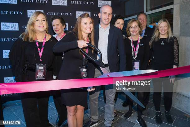 General Manager Jayda Palmer President Saks OFF 5TH and Gilt Jonathan Greller and team cut the ribbon to open Saks OFF 5th on October 19 2017 in...