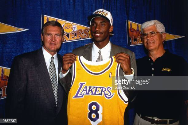 General Manager Jerry West Kobe Bryant and Head Coach Del Harris of the Los Angeles Lakers stand together to present Bryant at a press conference on...