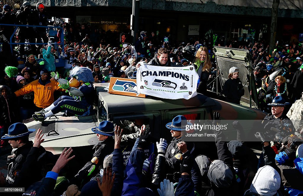 General Manager John Schneider of the Seattle Seahawks waves to fans during a parade to celebrate their victory in Super Bowl XLVII on February 5, 2014 in Seattle, Washington.