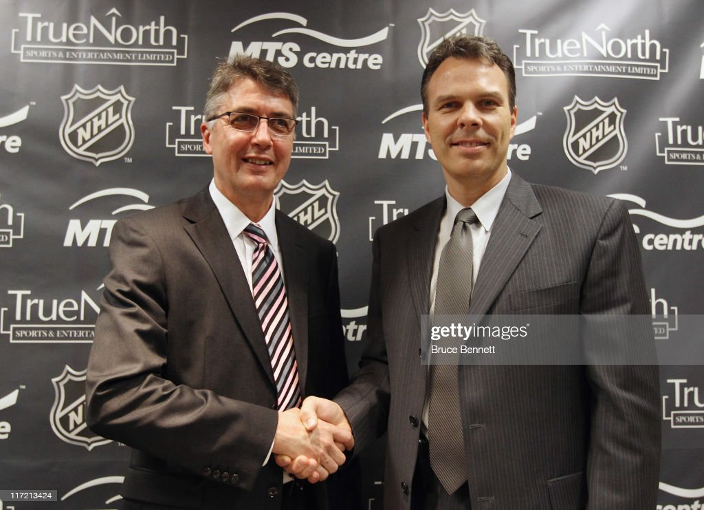 General Manager Kevin Cheveldayoff (R) of the Winnipeg franchise of the National Hockey League introduces Claude Noel (L) as their new head coach at the Westin Hotel on June 23, 2011 in Minneapolis, Minnesota.