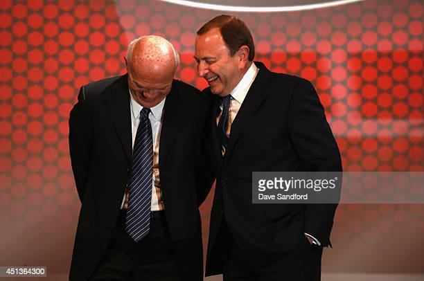 General manager Lou Lamoriello of the New Jersey Devils and NHL commissioner Gary Bettman laugh on stage during the 2014 NHL Entry Draft at Wells...