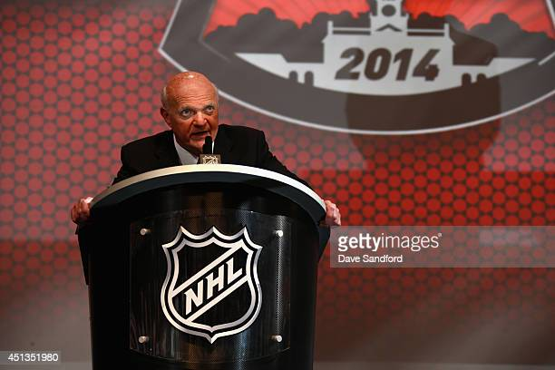 General manager Lou Lamoriello of the New Jersey Devils speaks at the podium during the 2014 NHL Entry Draft at Wells Fargo Center on June 27 2014 in...