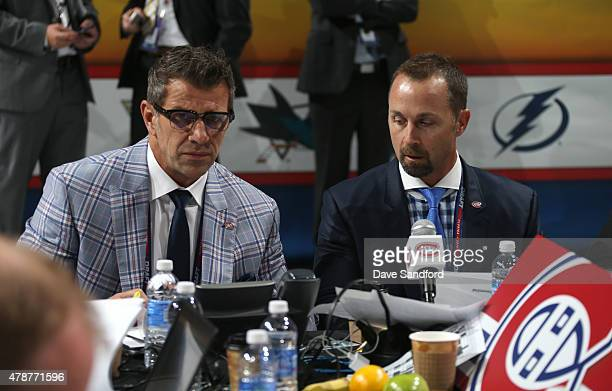 General Manager Marc Bergevin and Director Amateur Scouting Trevor Timmins of the Montreal Canadiens look over their notes during the 2015 NHL Draft...