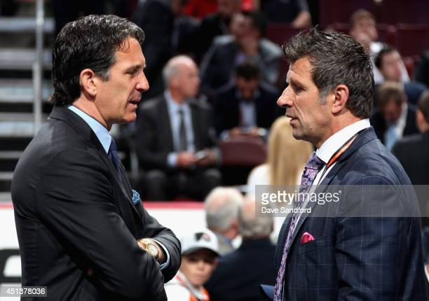 General manager Marc Bergevin of the Montreal Canadiens speaks with President and Alternate Governor Brendan Shanahan of the Toronto Maple Leafs...