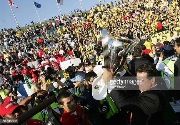General Manager Mark McCullers of the Columbus Crew hoist the cup after defeating the New York Red Bulls at the Home Depot Center during the 2008 MLS...