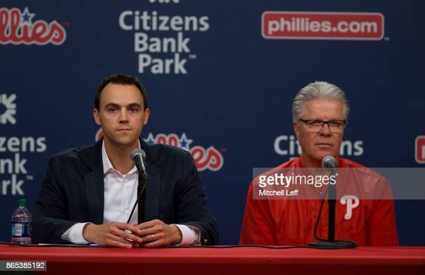 General manager Matt Klentak of the Philadelphia Phillies and manager Pete Mackanin talk to the media prior to the game against the New York Mets at...