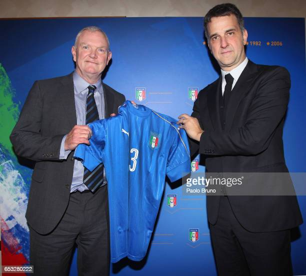 FIGC General Manager Michele Uva and FA Chairman Greg Clarke pose with Italy's jersey on March 14 2017 in Rome Italy