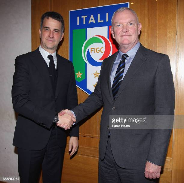 FIGC General Manager Michele Uva shakes the hands with FA Chairman Greg Clarke on March 14 2017 in Rome Italy