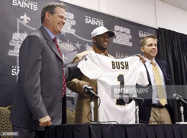 General Manager Mickey Loomis 2006 second overall NFL draft pick Reggie Bush and head coach Sean Payton of the New Orleans Saints pose together...