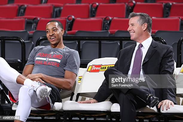 General Manager Neil Olshey and CJ McCollum of the Portland Trail Blazers speak before the game against the Indiana Pacers on December 3 2015 at the...