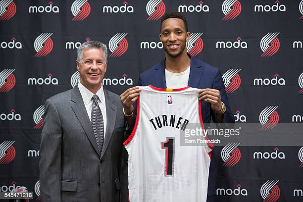 General Manager Neil Olshey and Evan Turner of the Portland Trail Blazers pose for a photo during Turner's media introduction July 7 2016 at the...