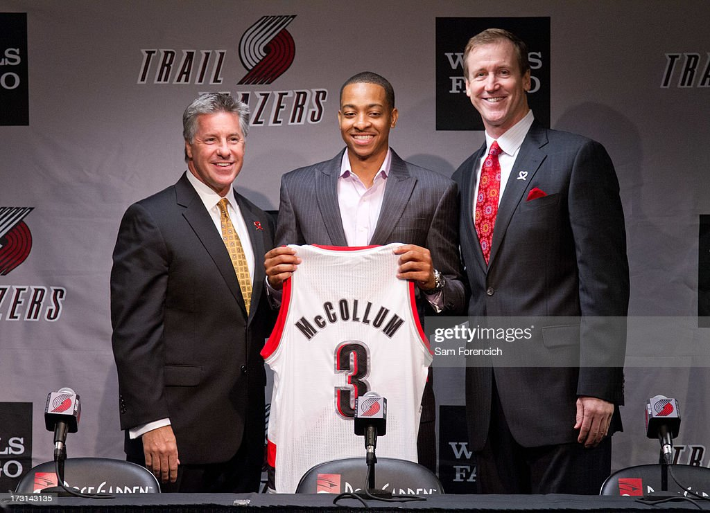 General Manager Neil Olshey (left) and head coach Terry Stotts (right) of the Portland Trail Blazers pose for a photo with NBA draft pick C.J. McCollum of the Portland Trail Blazers during a press conference July 8, 2013 at the Rose Garden Arena in Portland, Oregon.