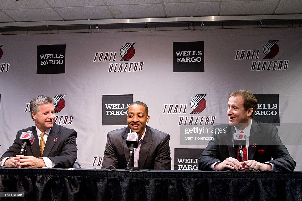 General Manager Neil Olshey (left) and head coach Terry Stotts (right) of the Portland Trail Blazers look on as NBA draft pick C.J. McCollum of the Portland Trail Blazers is introduced to the local media July 8, 2013 at the Rose Garden Arena in Portland, Oregon.