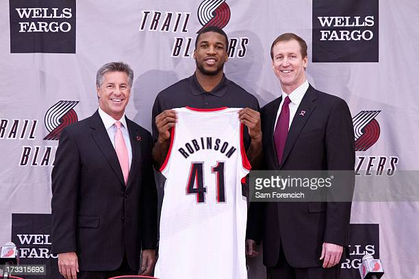 General Manager Neil Olshey and Head Coach Terry Stotts of the Portland Trail Blazers introduce newly acquired player Thomas Robinson during a press...