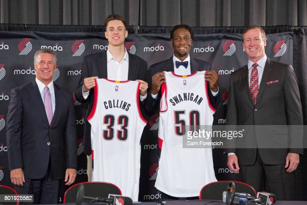 General Manager Neil Olshey and Head Coach Terry Stotts of the Portland Trail Blazers introduce Zach Collins and Caleb Swanigan to the media during a...
