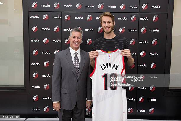 General Manager Neil Olshey and Jake Layman of the Portland Trail Blazers pose for a photo during Layman's media introduction July 7 2016 at the...