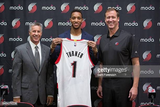 General Manager Neil Olshey Evan Turner and Head Coach Terry Stotts of the Portland Trail Blazers pose for a photo during Turner's media introduction...