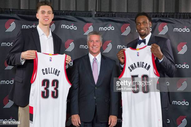 General Manager Neil Olshey of the Portland Trail Blazers introduces Zach Collins and Caleb Swanigan to the media during a press conference on June...