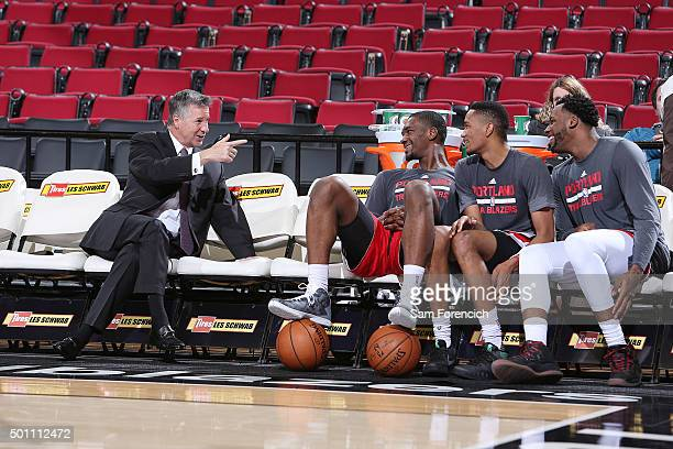 General Manager Neil Olshey of the Portland Trail Blazers jokes with team members Noah Vonleh #44 Luis Montero and Cliff Alexander prior to the game...