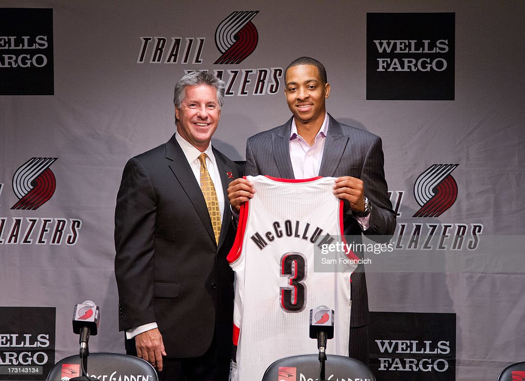 General Manager Neil Olshey (left) of the Portland Trail Blazers poses for a photo with NBA draft pick C.J. McCollum of the Portland Trail Blazers during a press conference July 8, 2013 at the Rose Garden Arena in Portland, Oregon.