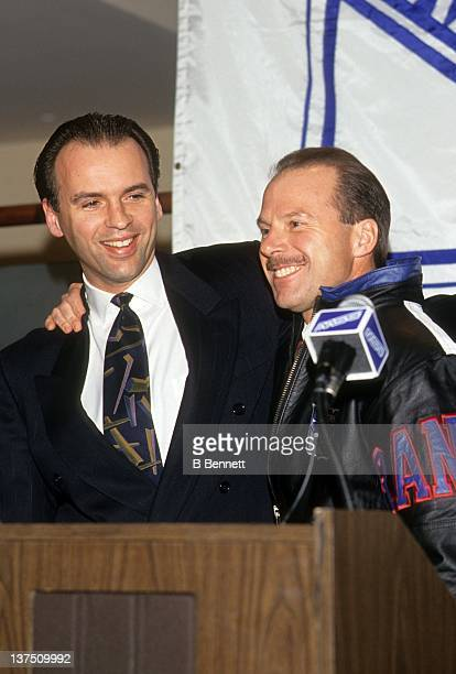 General manager Neil Smith of the New York Rangers introduces the new head coach Mike Keenan circa 1993 in New York New York