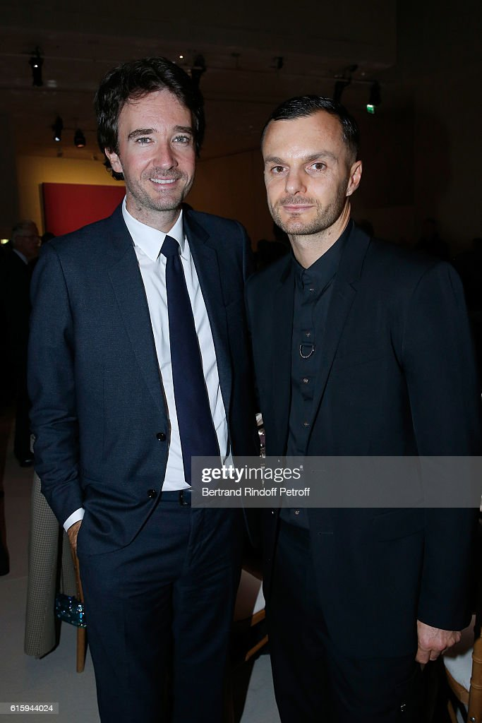 General manager of Berluti Antoine Arnault and Stylist Kris Van Assche attend the 'Icones de l'Art Moderne, La Collection Chtchoukine' : Cocktail at Fondation Louis Vuitton on October 20, 2016 in Paris, France.
