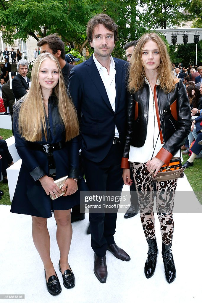 General manager of Berluti <a gi-track='captionPersonalityLinkClicked' href=/galleries/search?phrase=Antoine+Arnault&family=editorial&specificpeople=676045 ng-click='$event.stopPropagation()'>Antoine Arnault</a> standing between <a gi-track='captionPersonalityLinkClicked' href=/galleries/search?phrase=Natalia+Vodianova&family=editorial&specificpeople=203265 ng-click='$event.stopPropagation()'>Natalia Vodianova</a> (R) and her sister Kristina Kusakina attend the Berluti show as part of the Paris Fashion Week Menswear Spring/Summer 2015. Held at 'Ecole des Mines' on June 27, 2014 in Paris, France.