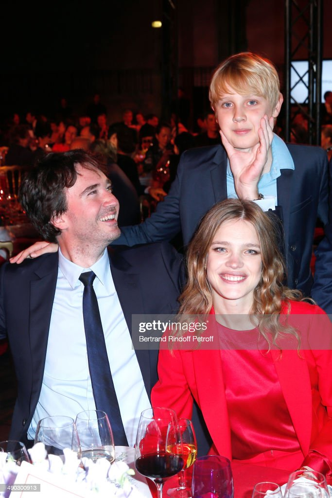 General manager of Berluti <a gi-track='captionPersonalityLinkClicked' href=/galleries/search?phrase=Antoine+Arnault&family=editorial&specificpeople=676045 ng-click='$event.stopPropagation()'>Antoine Arnault</a> (L) with Model and President of the 'Naked Heart Foundation' <a gi-track='captionPersonalityLinkClicked' href=/galleries/search?phrase=Natalia+Vodianova&family=editorial&specificpeople=203265 ng-click='$event.stopPropagation()'>Natalia Vodianova</a> and her son Lucas attend 'The strange city' Exhibition by Ilya and Emilia Kabakov at Monumenta 2014 : Dinner to benefit 'Naked Heart Foundation'. Held at Grand Palais on May 13, 2014 in Paris, France.