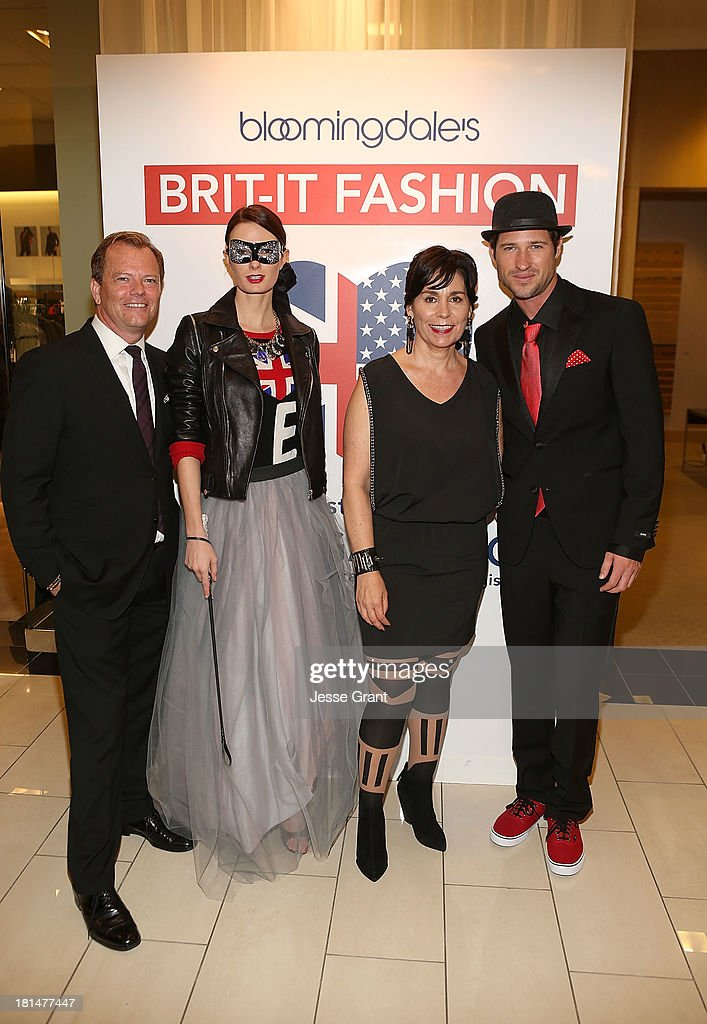 General Manager of Bloomingdale's South Coast Plaza Jim Murphy (L) and Orange County Register Fashion Editor Julie Gallego (2nd From Right) attend the Brit-It-Fashion show at Bloomingdale's South Coast Plaza on September 21, 2013 in Costa Mesa, California.
