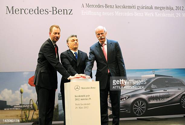 General Manager of Daimler AG Dieter Zetsche Hungarian Prime Minister Viktor Orban and chief of local factory Frank Klein push a symbolical button to...