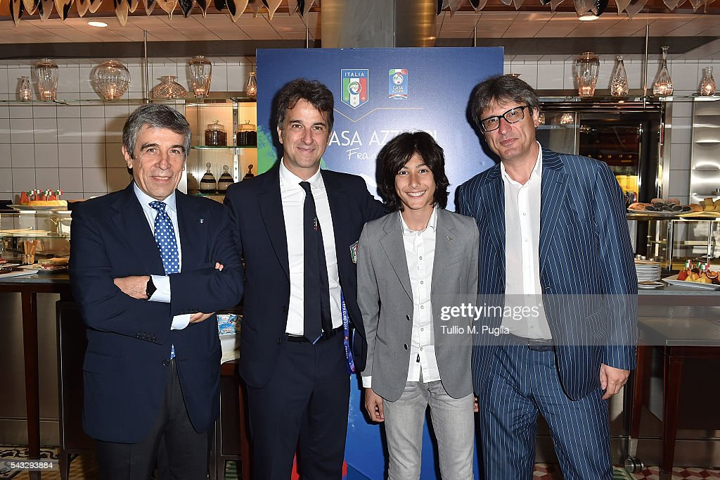 General Manager of FIGC Michele Uva (2nd-L) pose with guests at Casa Azzurri on Tour on June 27, 2016 in Paris, France.