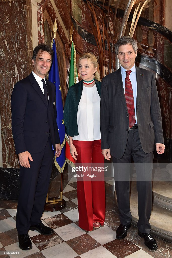 General Manager of FIGC Michele Uva (L) pose with The Ambassador of Italy to France Giandomenico Magliano and his wife Giada Magliano pose during at Embassy of Italy to France during Casa Azzurri on Tour on June 27, 2016 in Paris, France.
