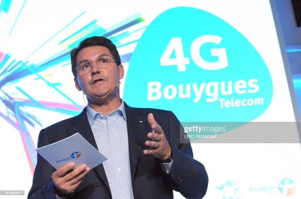 General Manager of French mobile telecommunications operator Bouygues Telecom, Olivier Roussat, speaks on September 25, 2013 in Paris during a press conference presenting Bouygues Telecom's 4G offer. Bouygues Telecom will cover 63 percent of the population with 4G internet access on it's first day of function, October 1.