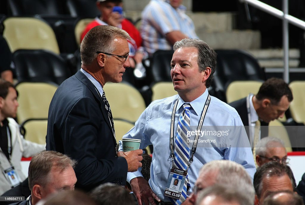 General Manager of the Philadelphia Flyers Paul Holmgren speaks with Pittsburgh Penguins general manager Ray Shero during day two of the 2012 NHL Entry Draft at Consol Energy Center on June 23, 2012 in Pittsburgh, Pennsylvania.