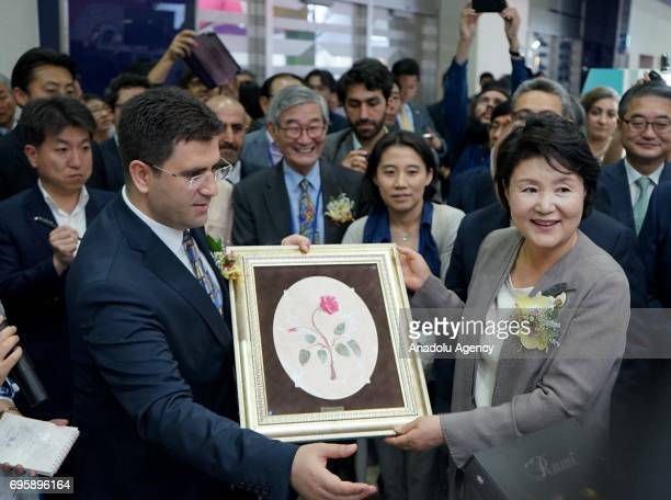 General Manager of Turkey's Libraries and Publications Hamdi Tursucu presents a marble painting to South Korean president Moon Jaein's wife Kim...