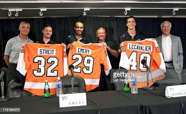 General Manager Paul Holmgren COO Peter Luukko and Chairman Ed Snider pose with newlyacquired Mark Streit Ray Emery and Vincent Lecavalier of the...
