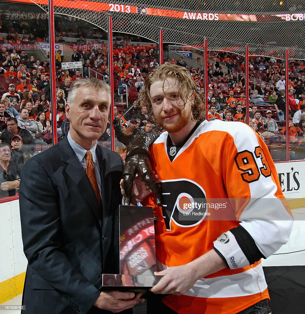 General Manager Paul Holmgren of the Philadelphia Flyers presents the Bobby Clarke Trophy for the team's Most Valuable Player to <a gi-track='captionPersonalityLinkClicked' href=/galleries/search?phrase=Jakub+Voracek&family=editorial&specificpeople=4111797 ng-click='$event.stopPropagation()'>Jakub Voracek</a> #93 prior to a game against the New York Islanders on April 25, 2013 at the Wells Fargo Center in Philadelphia, Pennsylvania.