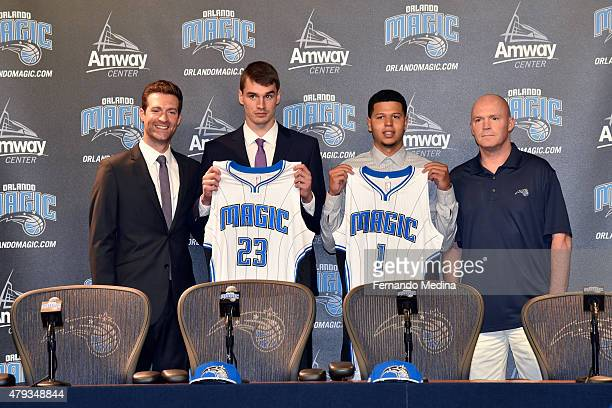 General Manager Rob Hennigan and Head Coach Scott Skiles introduce new Orlando Magic draft picks Mario Hezonja and Tyler Harvey during a press...