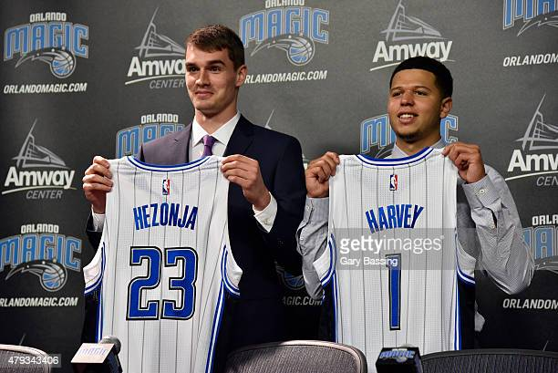 General Manager Rob Hennigan introduces new Orlando Magic draft picks Mario Hezonja and Tyler Harvey during a press conference on July 2 2015 at...