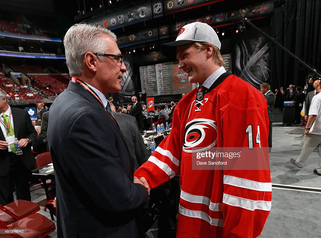 General Manager Ron Francis congratulates Josh Wesley after he was selected 96th overall by the Carolina Hurricanes during the 2014 NHL Entry Draft at Wells Fargo Center on June 28, 2014 in Philadelphia, Pennsylvania. Wesley is the son of former Carolina Hurricane, Glen Wesley.