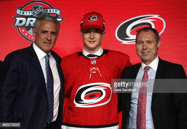 General manager Ron Francis left of the Carolina Hurricanes and Martin Necas 12th overall pick of the Carolina Hurricanes pose for a photo onstage...