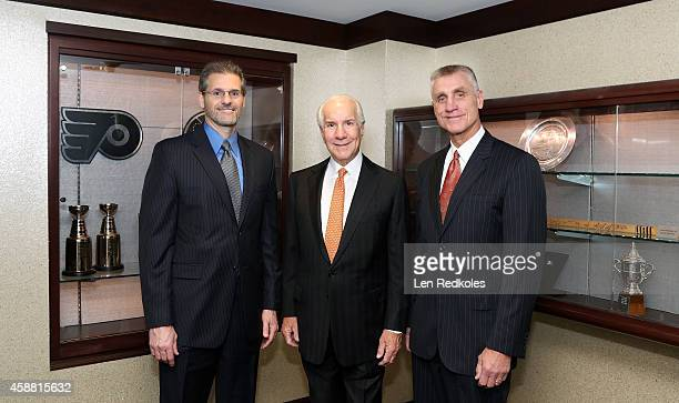General Manager Ron Hextall Chairman Ed Snider and President Paul Holmgren of the Philadelphia Flyers pose for a photo prior to a game against the...